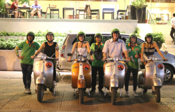 Ho Chi Minh tour nocturno de gastronomía en Vespa